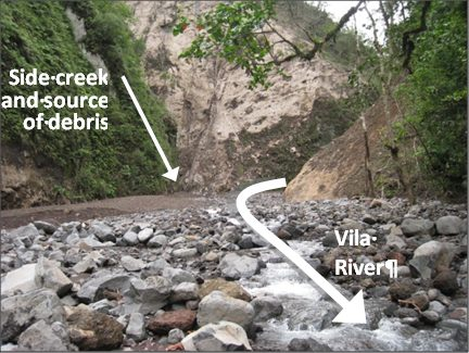 Looking up Vila River at debris field coming from creek on left.